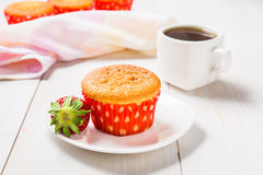 Muffin decorated with strawberry and coffee Royalty Free Stock Image