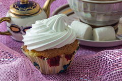 Muffin, decorated with whipped protein cream Stock Image