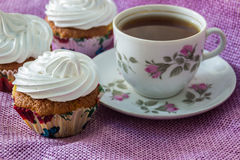 Muffin, decorated with whipped protein cream  and cup of  tea Stock Photography