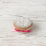 Muffin decorated with white hearts Stock Images