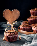 Muffin decorated with wooden heart tag Royalty Free Stock Photos