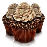 Muffin del cioccolato con la guarnizione della crema di amaretto Fotografia Stock Libera da Diritti