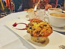 A muffin for dinner. A view of a muffin on a dinner table Royalty Free Stock Photos