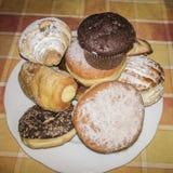 Muffin & donuts & giffel Arkivbilder