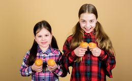 Muffin fight. Small children happy smiling with quickbread muffins. Happy little girls baking breakfast muffins at home stock photos