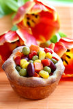 Muffin filled with vegetables on orange table cloth Stock Images