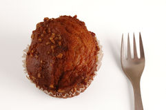 Muffin and Fork. A muffin on white, with fork Stock Image