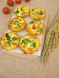 Muffin frittatas with rice, carrots, broccoli and tomatoes Royalty Free Stock Image