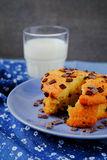 Muffin and a glass of milk on the table with blue tablecloth. Stock Photos