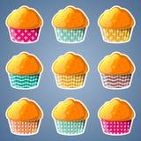 Muffin i pappers- koppar royaltyfri illustrationer