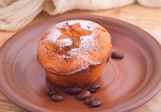 Muffin with icing sugar star and coffee beans Royalty Free Stock Photos