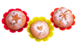 Muffin with icing sugar star, heart and sun in color forms Stock Image