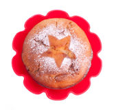 Muffin with icing sugar star in red form Royalty Free Stock Images