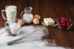 Muffin ingredients: milk, flour, sugar, eggs, butter Stock Images