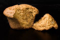 Muffin Irresistable. Photo of a half-eaten muffin. Temptation rules Stock Images