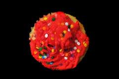 muffin isolerad röd överkant Arkivbilder