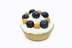 Muffin with italian pastries called amaretti and blueberries Royalty Free Stock Photo