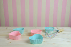 Muffin Liners on Kitchen Table Royalty Free Stock Photography