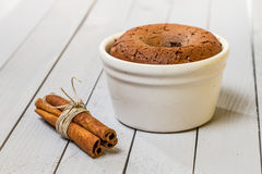 Muffin with liquid chocolate inside Stock Photography