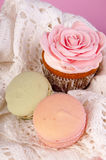 Muffin and macarons Royalty Free Stock Image