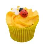 Muffin med camomilen och nyckelpigan Royaltyfri Foto