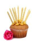 Muffin med en stearinljus Arkivfoto