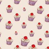 Muffin med körsbär och den drog krämhanden skissar på rosa bakgrund seamless vektor för modell Arkivfoto