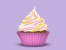 Muffin med mång--färg kräm Arkivbild