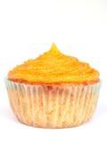 Muffin med orange toppning Fotografering för Bildbyråer