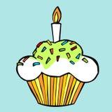 Muffin met kaars Stock Afbeelding