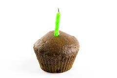 Muffin mit Kerze Lizenzfreie Stockbilder