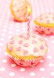 Muffin mit Kerze für sie Lizenzfreie Stockfotos
