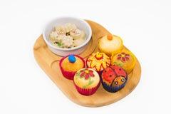 Muffin och choklader Arkivfoton