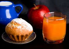 Muffin and orange juice Royalty Free Stock Image