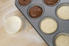 Muffin paper cups and muffin pan Stock Images