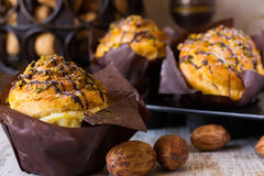 Muffin with pistachios in kraft paper Stock Image