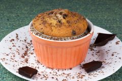 Muffin on a plate with chocolate chips. Muffin on a white plate with chocolate chips Royalty Free Stock Images