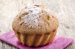 Muffin with powdered sugar on a pink napkin Royalty Free Stock Image