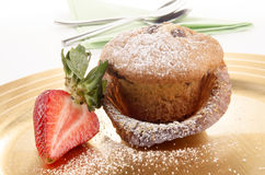 Muffin with powdered sugar and strawberry Royalty Free Stock Photography