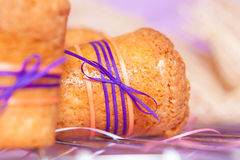 Muffin with purple ribbon Stock Photos