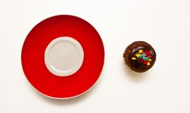 Muffin and Red plate Royalty Free Stock Photos