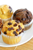 Muffin Series 02. Different favor baked muffin on bamboo mat Royalty Free Stock Images