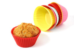 Muffin in silicone baking cup. With a stack of silicone baking cups Royalty Free Stock Images