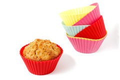 Muffin in silicone baking cup 2. Muffin in silicone baking cup with a stack of silicone baking cups Royalty Free Stock Photos