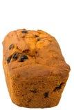 Muffin som bakar det hemlagade russinet som isoleras på den suddiga selektiva fokusen för vit bakgrund Royaltyfri Fotografi