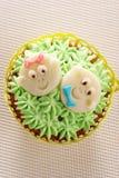 Muffin som dekoreras med babyansikten Royaltyfria Foton