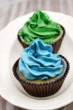 Muffin som dekoreras med buttercream arkivfoton