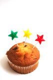 Muffin and star candles Stock Images