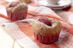Muffin with strawberry. Homemade muffin with strawberry and sugarcane Stock Images