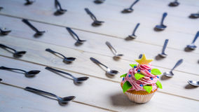 Muffin surrounded by teaspoon Stock Photo